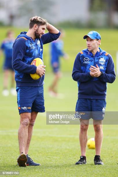 Jarrad Waite of the Kangaroos speaks to a physician moments after he announced that he was missing from this weekend due to a lower leg injury during...