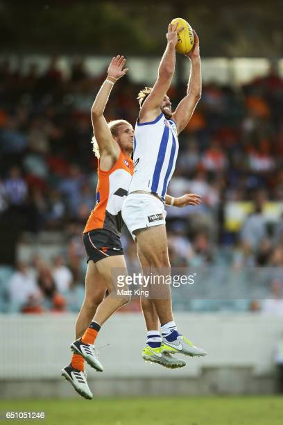 Jarrad Waite of the Kangaroos takes a mark under pressure from Nick Haynes of the Giants during the JLT Community Series AFL match between the...