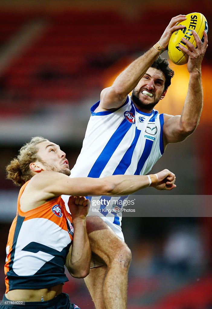 Jarrad Waite of the Kangaroos takes a mark under pressure from Cameron McCarthy of the Giants during the round 12 AFL match between the Greater Western Sydney Giants and the North Melbourne Kangaroos at Spotless Stadium on June 20, 2015 in Sydney, Australia.