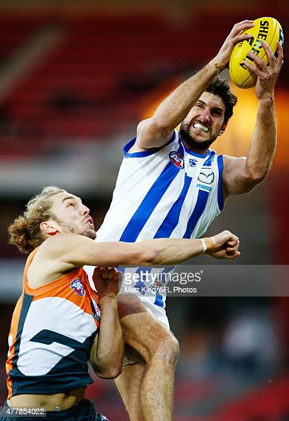 Jarrad Waite of the Kangaroos takes a mark under pressure from Cameron McCarthy of the Giants during the round 12 AFL match between the Greater...