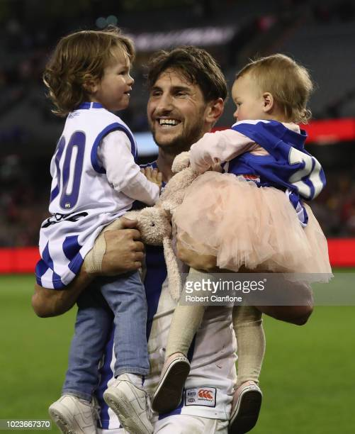 Jarrad Waite of the Kangaroos walks off the ground with his chidren Teddy and Lola after playing his last AFL match during the round 23 AFL match...