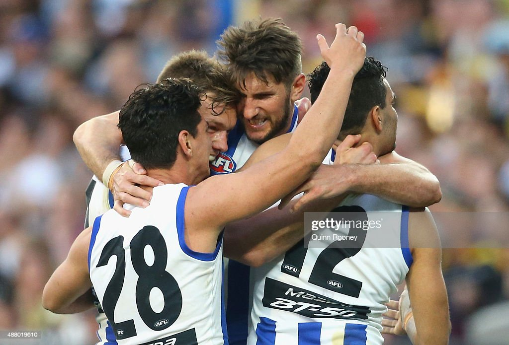 Jarrad Waite of the Kangaroosis congratulated by team mates after kicking a goal during the First AFL Elimination Final match between the Richmond Tigers and the North Melbourne Kangaroos at Melbourne Cricket Ground on September 13, 2015 in Melbourne, Australia.
