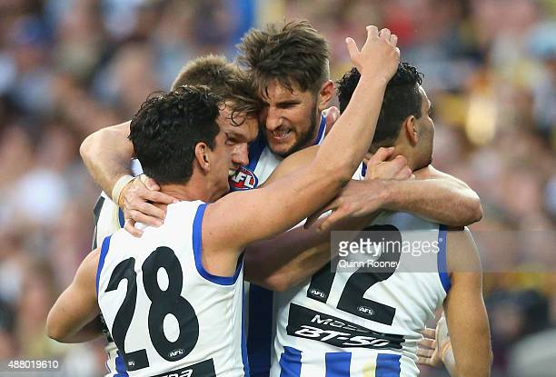 Jarrad Waite of the Kangaroosis congratulated by team mates after kicking a goal during the First AFL Elimination Final match between the Richmond...