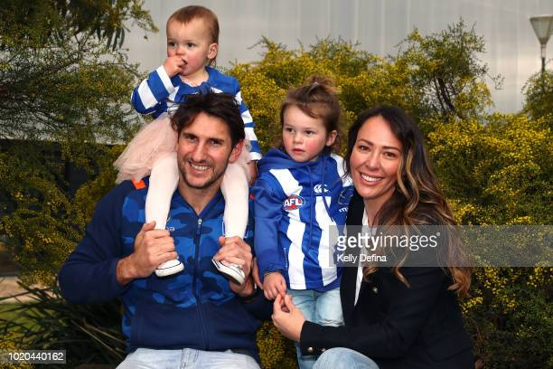 Jarrad Waite of the North Melbourne Kangaroos poses for a portrait with his family during a press conference at Arden Street Ground on August 21 2018...