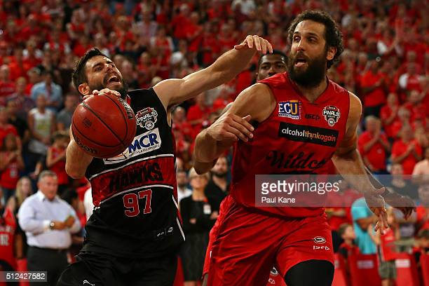 Jarrad Weeks of the Hawks goes to the basket against Matt Knight of the Wildcats during the NBL Semi Final match between Perth Wildcats and Illawarra...