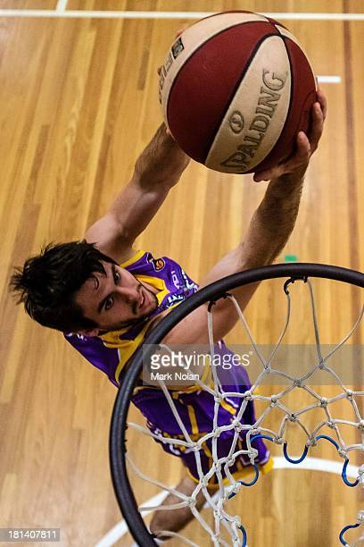 Jarrad Weeks of the Kings lays up before the 2013/14 Pre-season Blitz match between the Sydney Kings and the New Zealand Breakers at the North Sydney...