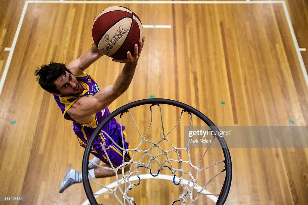 Jarrad Weeks of the Kings lays up before the 2013/14 Pre-season Blitz match between the Sydney Kings and the New Zealand Breakers at the North Sydney Indoor Sports Centre on September 21, 2013 in Sydney, Australia.