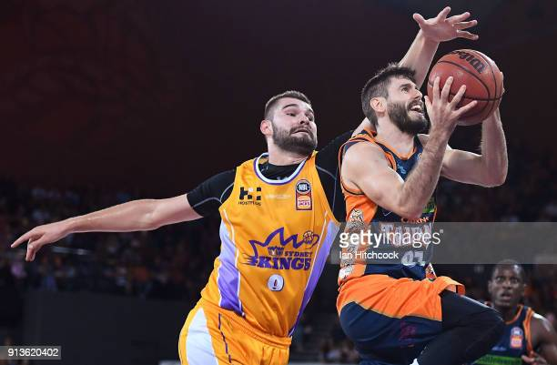 Jarrad Weeks of the Taipans drives to the basket despte the defence of Isaac Humphries of the Kings during the round 17 NBL match between the Cairns...