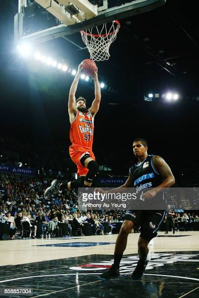 Jarrad Weeks of the Taipans goes to the basket against Edgar Sosa of the Breakers during the round one NBL match between the New Zealand Breakers and...