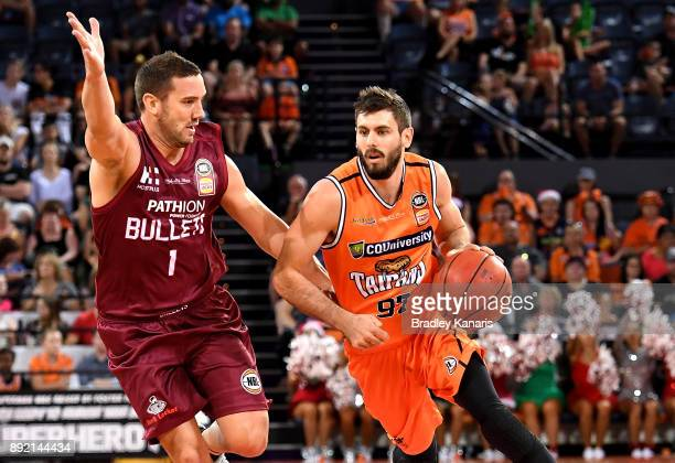 Jarrad Weeks of the Taipans takes on the defence during the round 10 NBL match between the Cairns Taipans and the Brisbane Bullets at Cairns...