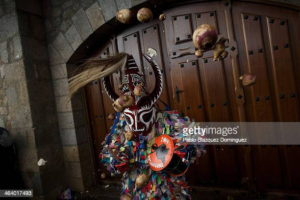 Jarramplas gets hit with turnips as he makes his way through the streets beating his drum during the Jarramplas Festival on January 19 2014 in...