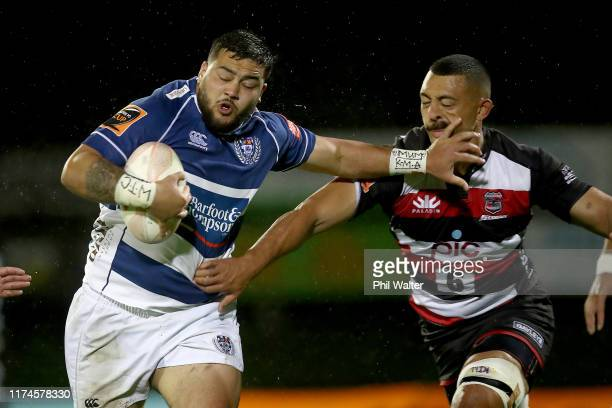 Jarred Adams of Auckland is tackled during the round 6 Mitre 10 Cup match between Counties Manukau and Auckland at Navigation Homes Stadium on...