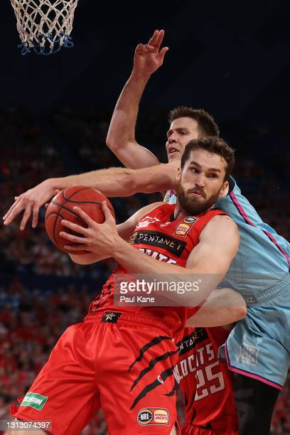 Jarred Bairstow of the Wildcats rebounds against Tom Abercrombie of the Breakers during the round 14 NBL match between the Perth Wildcats and the New...