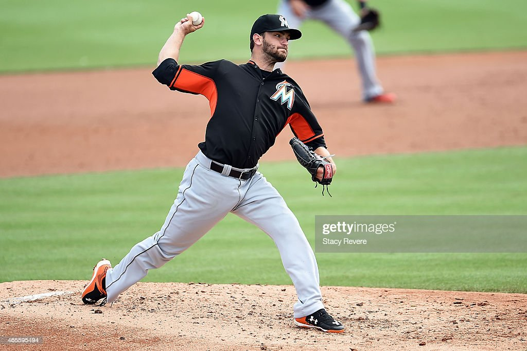 Jarred Cosart #23 of the Miami Marlins throws a pitch during the second inning of a spring training game against the St. Louis Cardinals at Roger Dean Stadium on March 8, 2015 in Jupiter, Florida.
