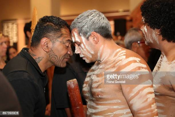 Jarred Fogarty of the Yugambeh clan is given a traditonal hongi after the Queens Baton presentation at Auckland War Memorial Museum during the...