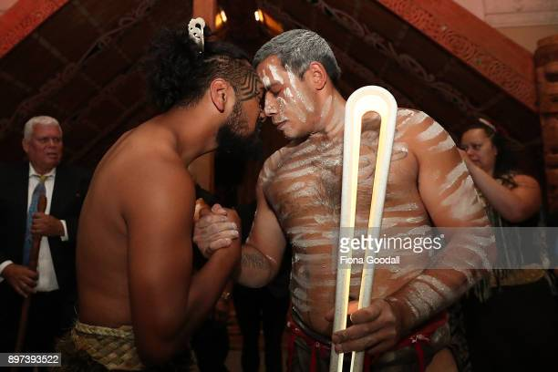 Jarred Fogarty of the Yugambeh clan receives the Queens Baton from a Maori Warrior at Auckland War Memorial Museum during the Commonwealth Games...