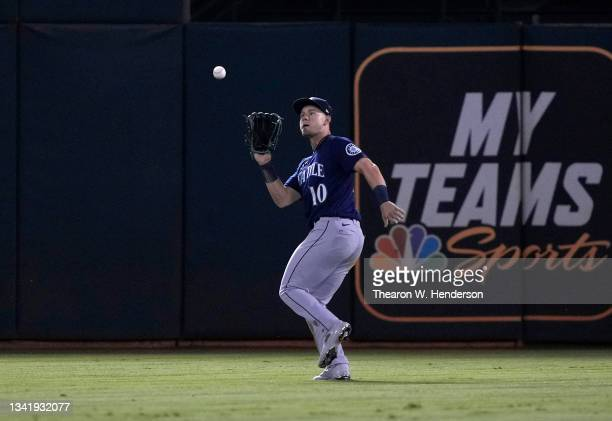 Jarred Kelenic of the Seattle Mariners catches a fly ball off the bat of Tony Kemp of the Oakland Athletics in the bottom of the seventh inning at...