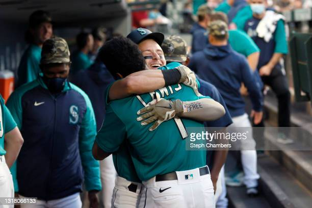 Jarred Kelenic of the Seattle Mariners reacts with Kyle Lewis after his two run home run against the Cleveland Indians during the third inning at...