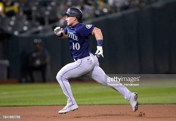 Jarred Kelenic of the Seattle Mariners runs the bases on his way to a triple against the Oakland Athletics in the top of the fourth inning at...