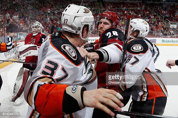 Jarred Tinordi of the Arizona Coyotes fights with Nick Ritchie of the Anaheim Ducks during the third period of the NHL game at Gila River Arena on...