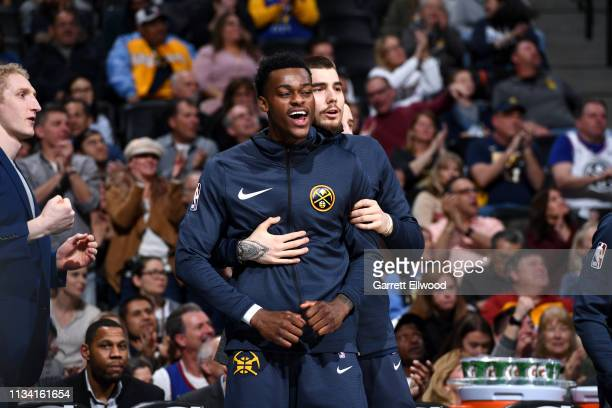 Jarred Vanderbilt and Juan Hernangomez of the Denver Nuggets react to a play during the game against the Washington Wizards on March 31 2019 at the...