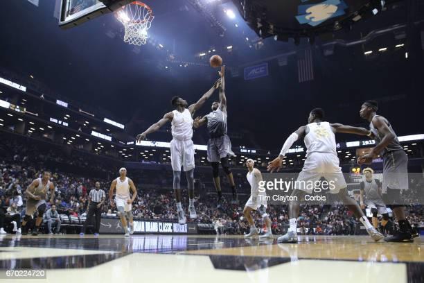 Jarred Vanderbilt Kentucky shoots over Mohamed Bamba during the Jordan Brand Classic National Boys Team AllStar basketball game at The Barclays...