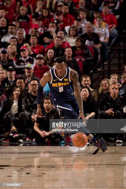 Jarred Vanderbilt of the Denver Nuggets handles the ball against the Portland Trail Blazers on April 7 2019 at the Moda Center Arena in Portland...