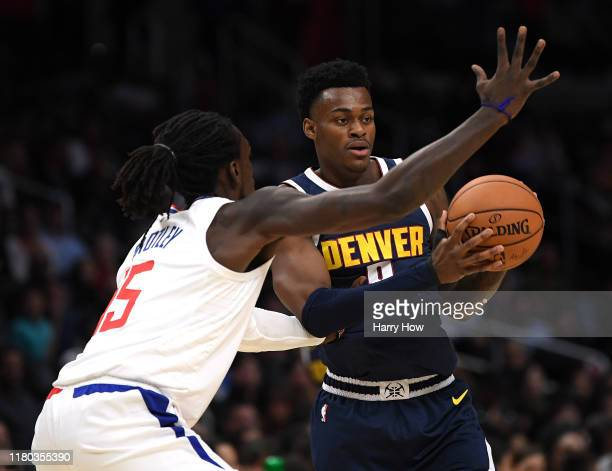 Jarred Vanderbilt of the Denver Nuggets looks to pass in front of Johnathan Motley of the LA Clippers during a 11191 Nuggets preseason win at Staples...