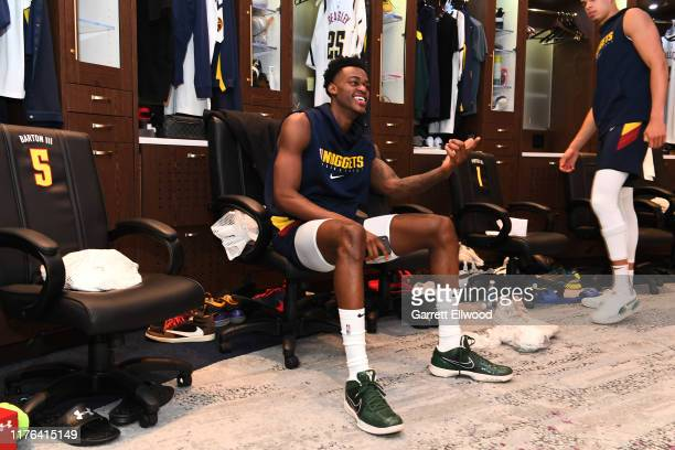 Jarred Vanderbilt of the Denver Nuggets smiles in the locker room prior to a preseason game against the Portland Trail Blazers on October 18 2019 at...