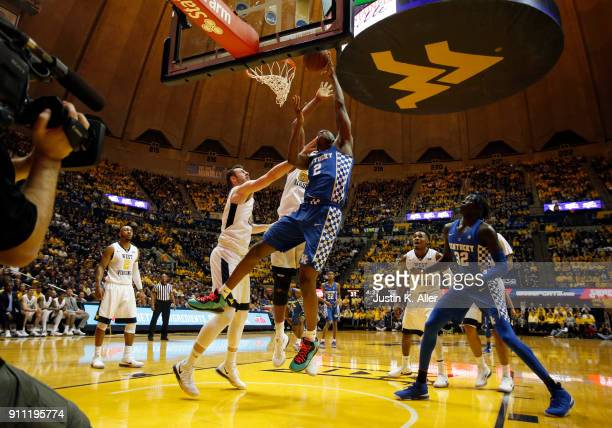 Jarred Vanderbilt of the Kentucky Wildcats attempts a lay up against Maciej Bender of the West Virginia Mountaineers at the WVU Coliseum on January...