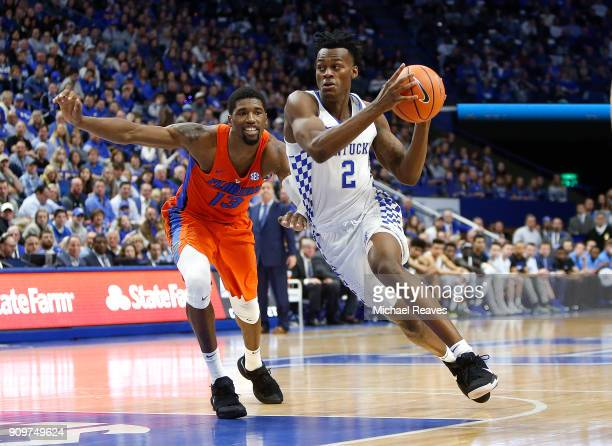 Jarred Vanderbilt of the Kentucky Wildcats drives to the basket past Kevarrius Hayes of the Florida Gators at Rupp Arena on January 20 2018 in...