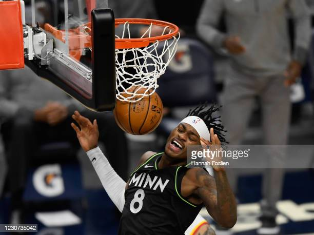Jarred Vanderbilt of the Minnesota Timberwolves reacts after dunking the ball against the Atlanta Hawks during the first quarter of the game at...