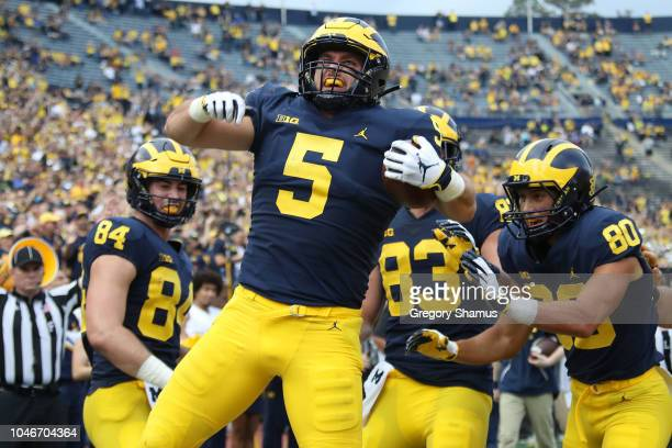 Jarred Wangler of the Michigan Wolverines celebrates a second half touchdown while playing the Maryland Terrapins on October 6 2018 at Michigan...