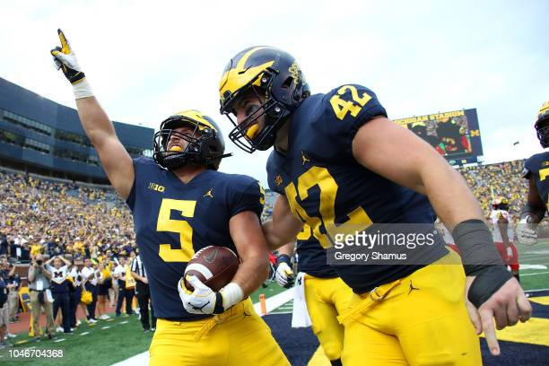 Jarred Wangler of the Michigan Wolverines celebrates a second half touchdown with Ben Mason while playing the Maryland Terrapins on October 6, 2018...