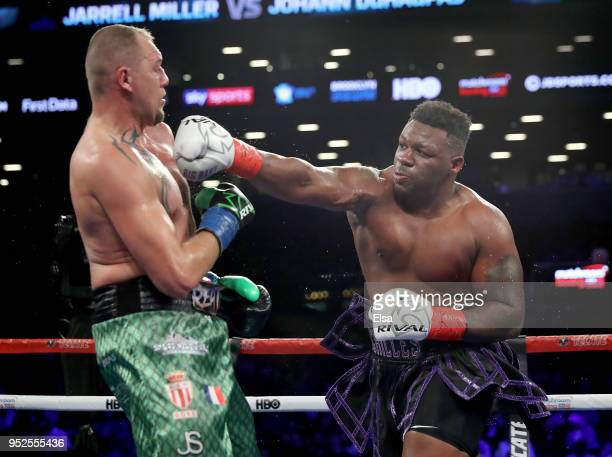 Jarrell Big Baby Miller of the United States and Johann Duhaupas of France exchange punches during their WBA Heavyweight match at Barclays Center on...