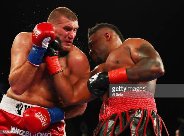 Jarrell Miller punches Mariusz Wach during their Heavyweight bout at Nassau Veterans Memorial Coliseum on November 11 2017 in Uniondale New York