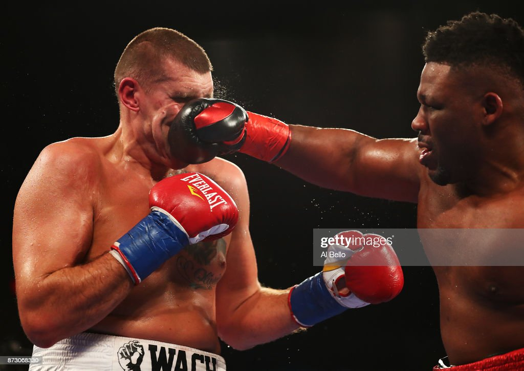 Jarrell Miller punches Mariusz Wach during their Heavyweight bout at Nassau Veterans Memorial Coliseum on November 11, 2017 in Uniondale, New York.