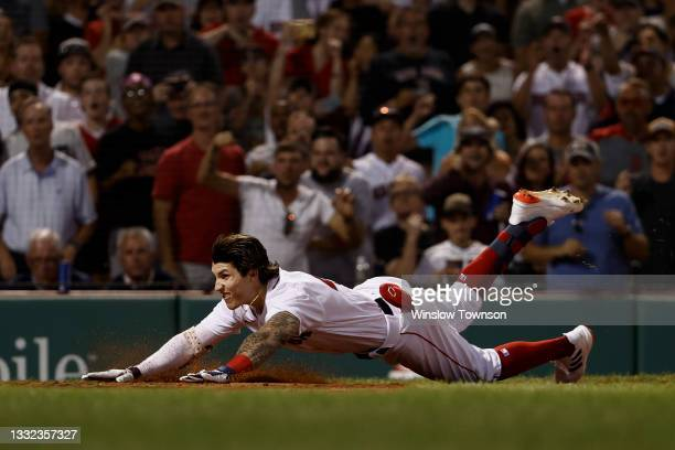 Jarren Duran of the Boston Red Sox dives into home plate against the Toronto Blue Jays during the fourth inning of game two of a doubleheader at...