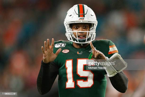 Jarren Williams of the Miami Hurricanes reacts after throwing his sixth touchdown of the game against the Louisville Cardinals during the second half...