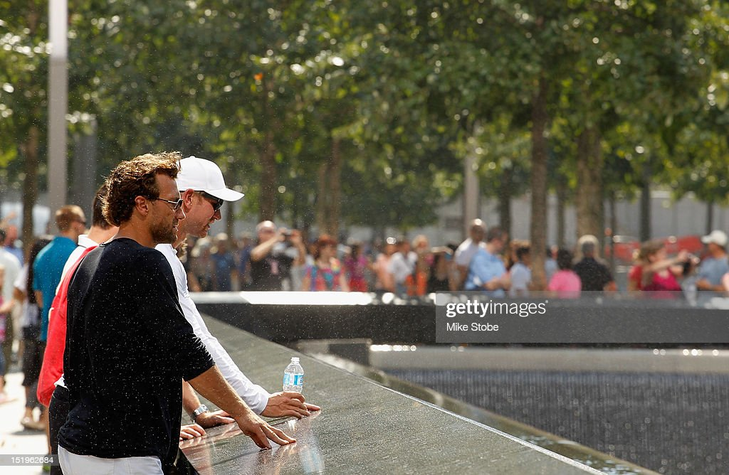 Jarret Stoll and Jeff Carter of the Los Angeles Kings tour the 9/11 Memorial in lower Manhattan at the World Trade Center site on September 13, 2012 in New York City.The Los Angeles Kings marked the loss of Garnet 'Ace' Bailey, the Kings' director of pro scouting, and amateur scout Mark Bavis when hijackers took control of their scheduled Boston-to-Los Angeles flight and crashed the plane into the south tower of New York's World Trade Center.