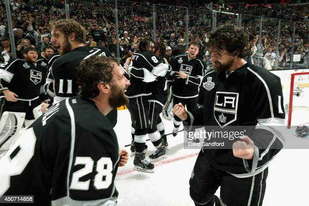 Jarret Stoll and Justin Williams of the Los Angeles Kings celebrate winning the Stanley Cup after teammate Alec Martinez scored the game-winning...
