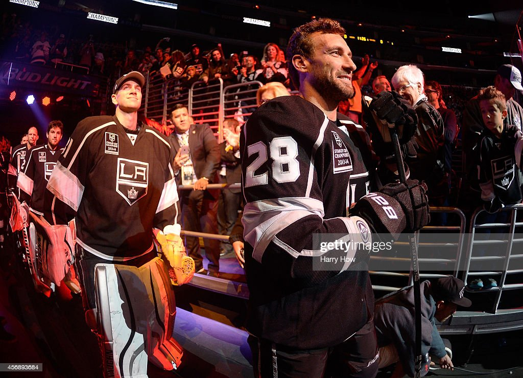 Jarret Stoll #28 and Martin Jones #31 of the Los Angeles Kings wait for their introduction before the season opening game against the San Jose Sharks at Staples Center on October 8, 2014 in Los Angeles, California.