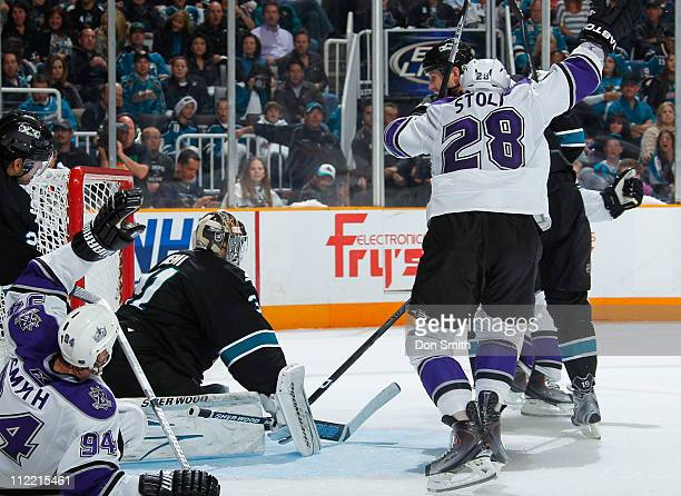 Jarret Stoll and Ryan Smyth of the Los Angeles Kings celebrate a second period goal against Antti Niemi and Joe Thornton of the San Jose Sharks in...
