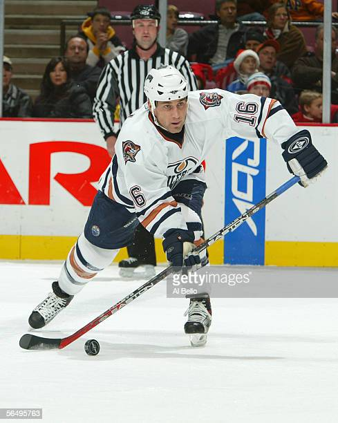 Jarret Stoll of the Edmonton Oilers passes the puck during the game against the New Jersey Devils on December 13 2005 at the Continental Airlines...