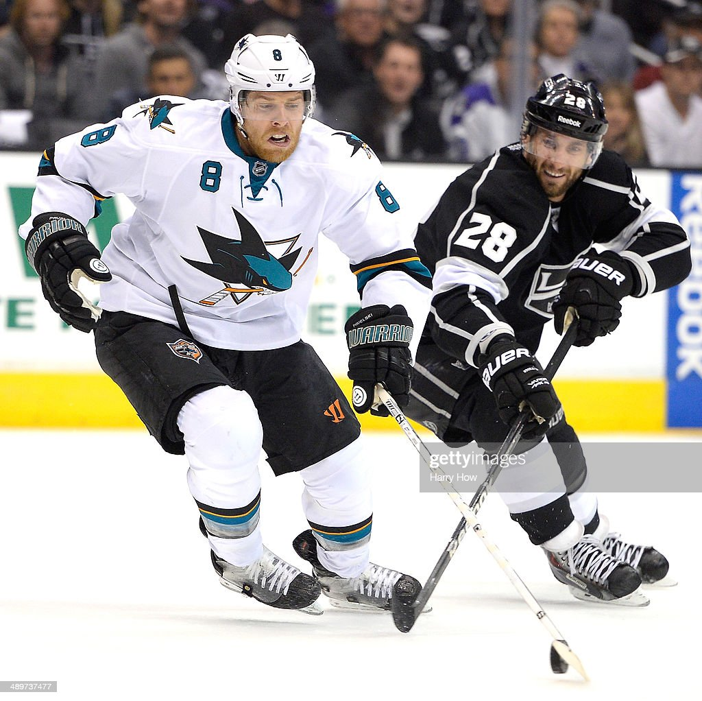 Jarret Stoll #28 of the Los Angeles Kings and Joe Pavelski #8 of the San Jose Sharks battle for the puck during the second period in Game Six of the First Round of the 2014 NHL Stanley Cup Playoffs at Staples Center on April 28, 2014 in Los Angeles, California.