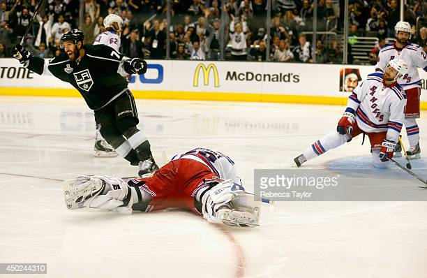 Jarret Stoll of the Los Angeles Kings celebrates his goal in the second period as goaltender Henrik Lundqvist of the New York Rangers goes down...