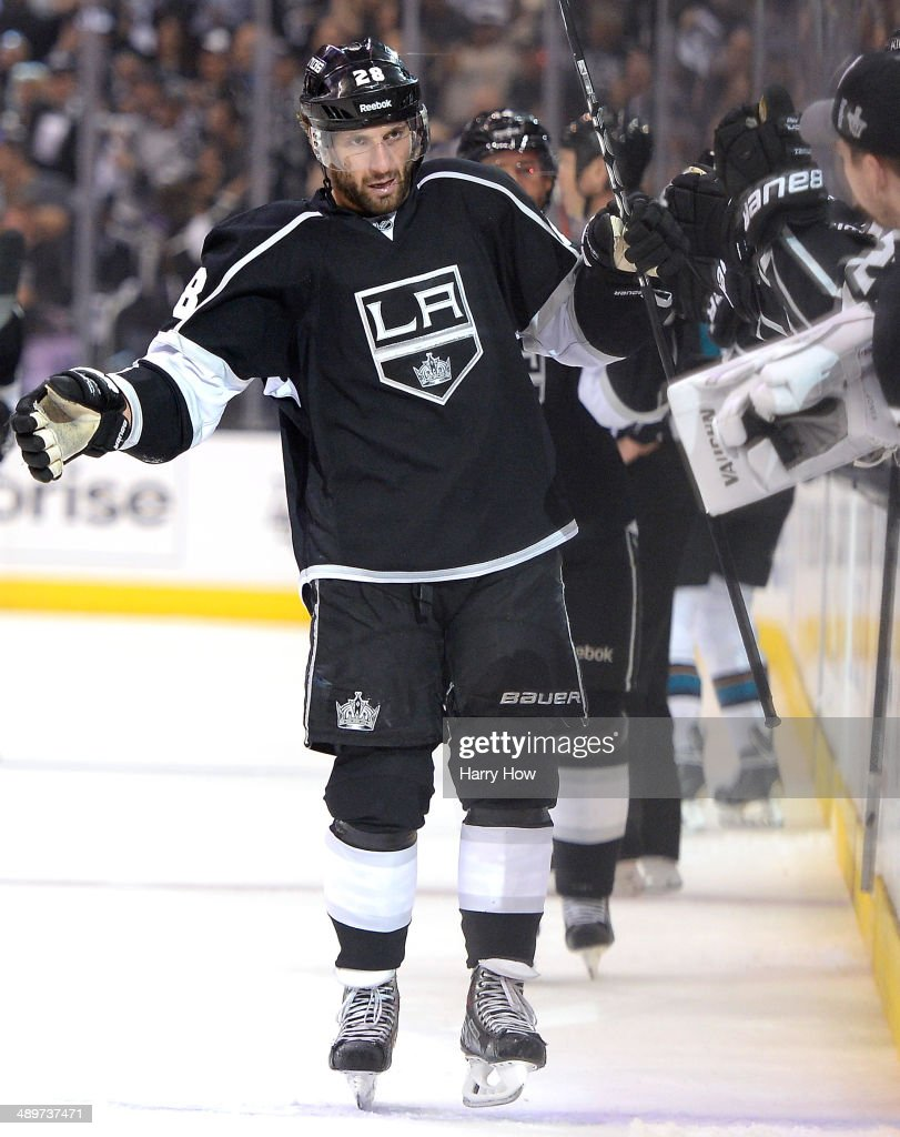 Jarret Stoll #28 of the Los Angeles Kings celebrates the goal of Justin Williams #14 with teammates during the first period to make the score 1-0 in Game Six of the First Round of the 2014 NHL Stanley Cup Playoffs at Staples Center on April 28, 2014 in Los Angeles, California.