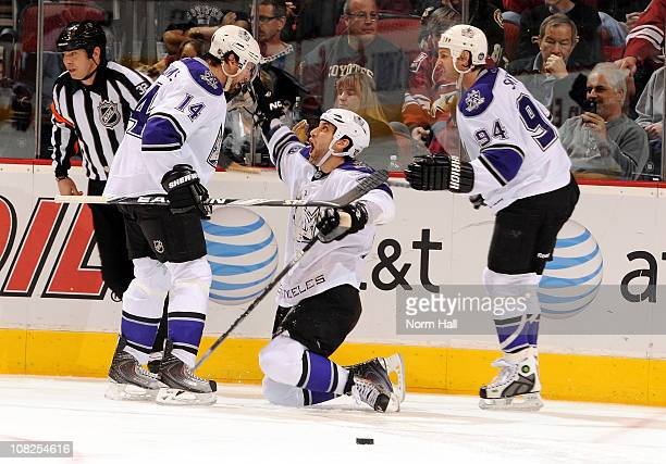 Jarret Stoll of the Los Angeles Kings celebrates with teammates Justin Williams and Ryan Smyth after scoring the gamewinning goal against the Phoenix...
