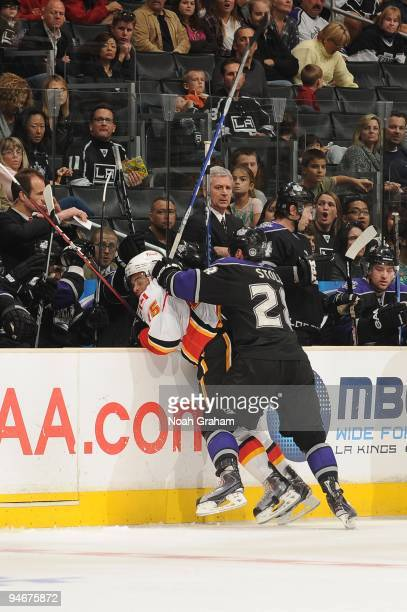 Jarret Stoll of the Los Angeles Kings checks Nigel Dawes of the Calgary Flames during their game at Staples Center on November 21, 2009 in Los...