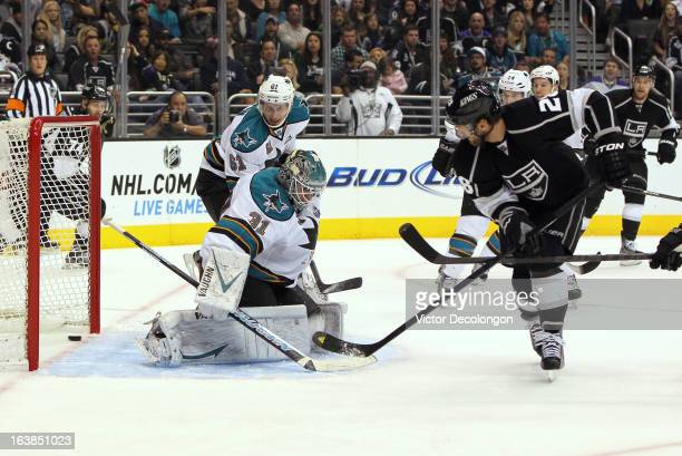Jarret Stoll of the Los Angeles Kings puts a backhand shot for a goal past goaltender Antti Niemi of the San Jose Sharks in the second period during...